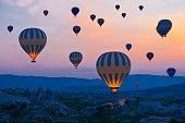 Hot air balloons rising at cappadocia - Turkey in the morning.