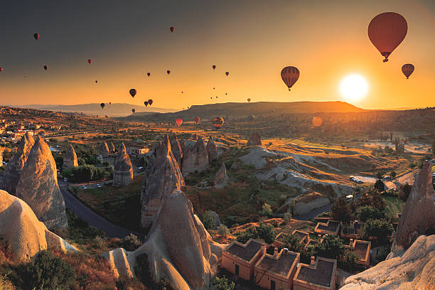 Cappadocia valley at sunrise Hot air balloon flying over spectacular Cappadocia turkish stock pictures, royalty-free photos & images