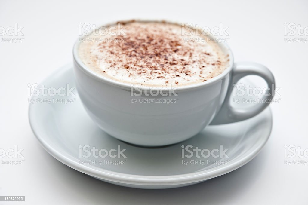 Cappuccino against plain background stock photo