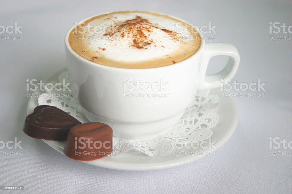 Cappuccino and chocolates royalty-free stock photo