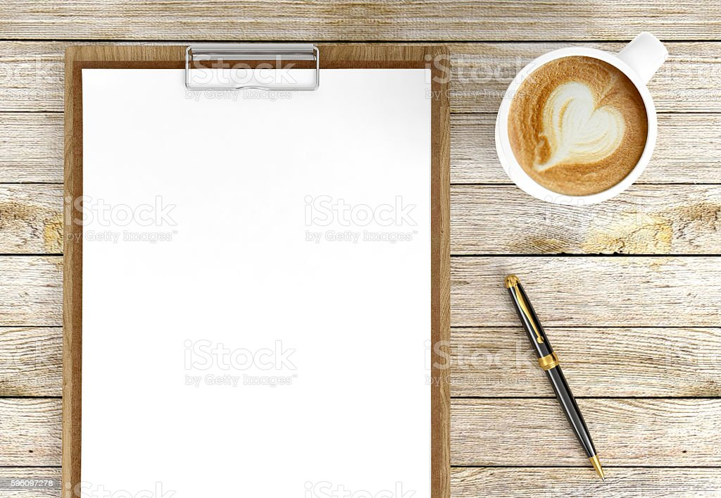 Cappuccino coffee cup with blank papers on clipboard and pen royalty-free stock photo