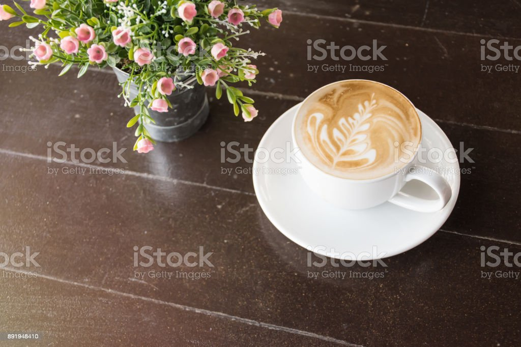 Cappuccino coffee cup with flower bouquet stock photo