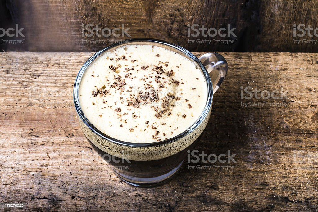 Cappuccino coffee foam cream topped with sprinkled chocolate royalty-free stock photo