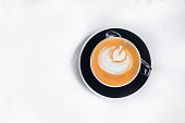 istock Cappuccino coffee on white table 831490978