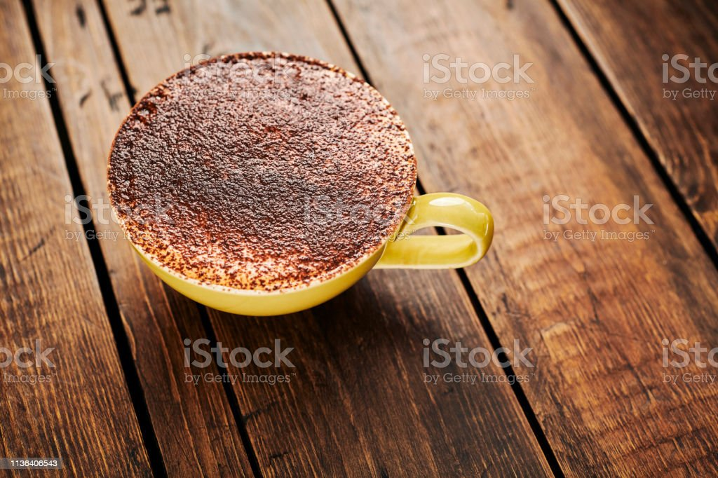 Cappuccino coffee topped with lots of chocolate sprinkles. stock photo