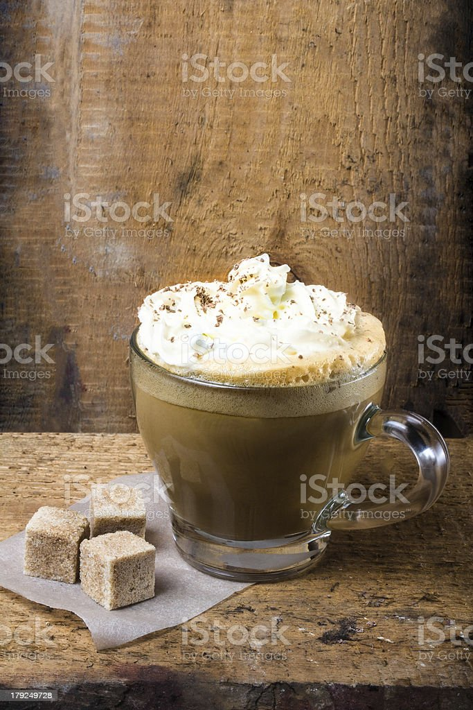 Cappuccino coffee with cream topped royalty-free stock photo