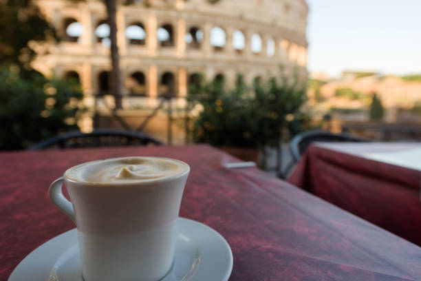 Cappuccino cup and Coliseum stock photo