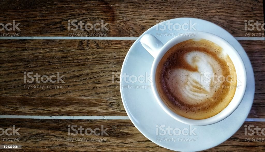 Cappuccino Cup standing on a Table royalty-free stock photo