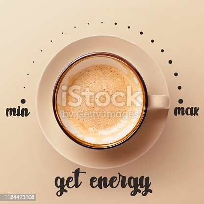 Get energy with coffee break. Cappuccino cup with saucer on beige background, top view