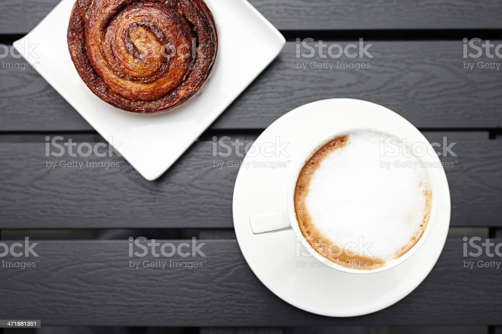 Cappuccino drink with danish pastry on table top view royalty-free stock photo