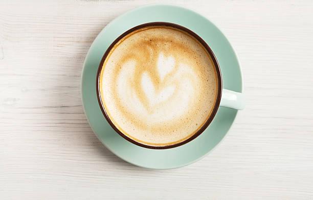 cappuccino foam, coffee cup top view on white wood background - porzellan druck stock-fotos und bilder