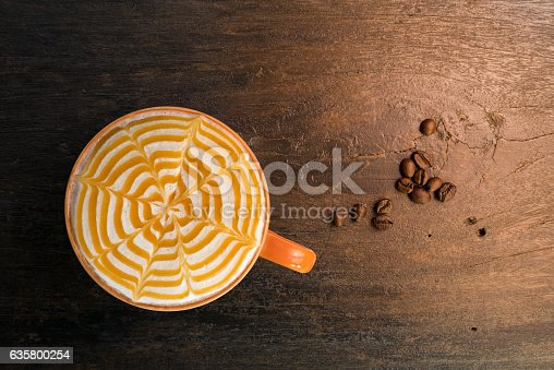 istock Cappuccino hot coffee caramel topping, top view. 635800254