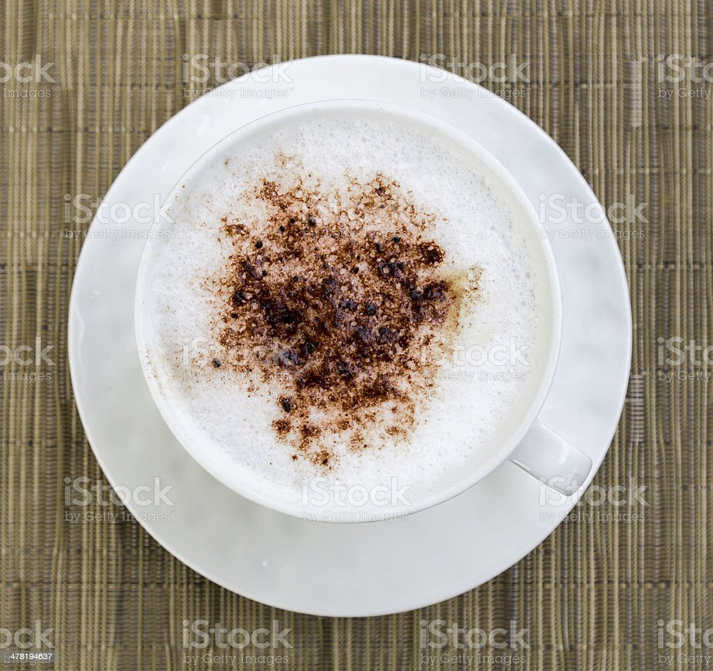 Cappuccino in a cup of cocoa royalty-free stock photo