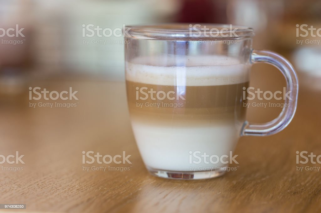 Cappuccino in clear glass stock photo