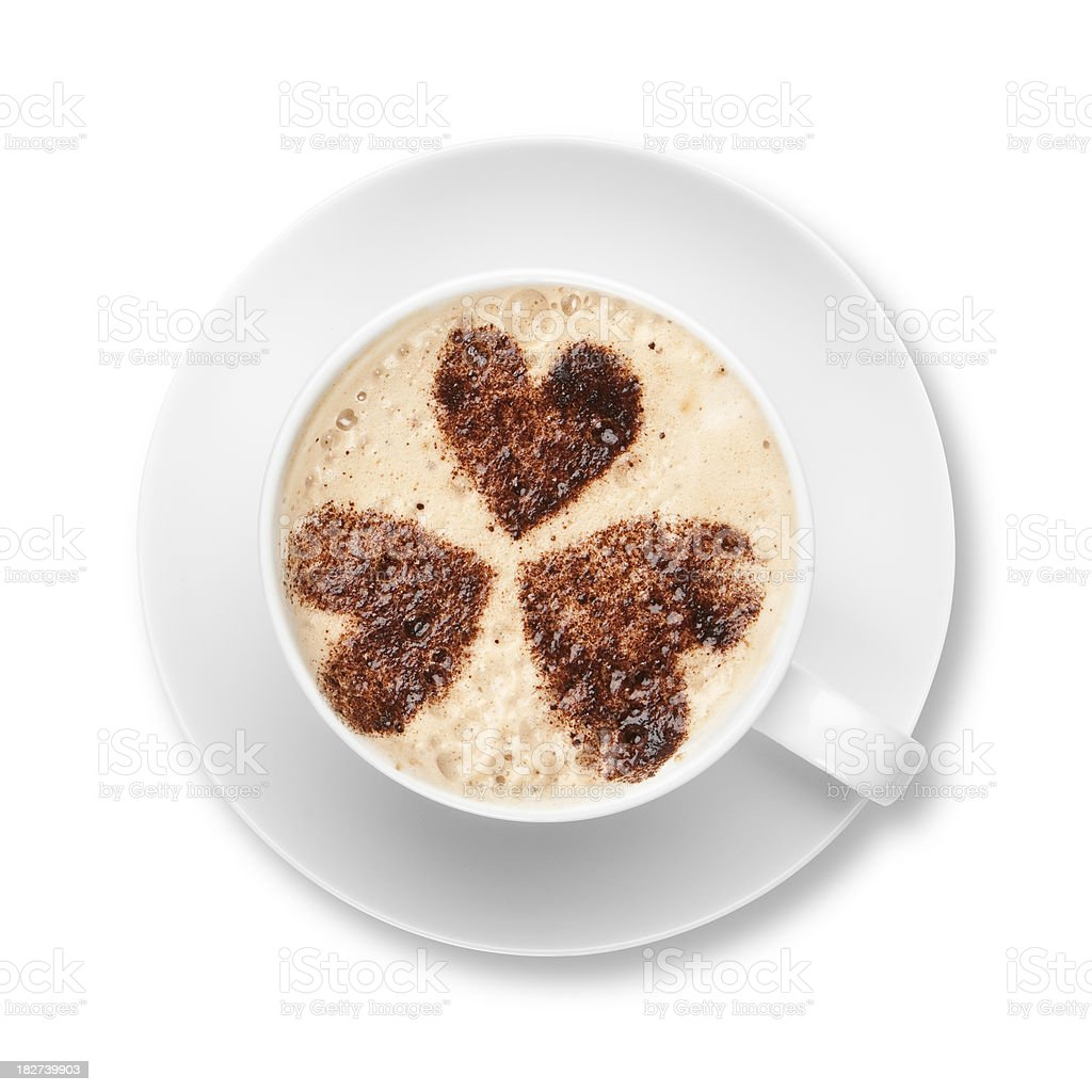 Cappuccino in white cup and saucer with chocolate hearts royalty-free stock photo
