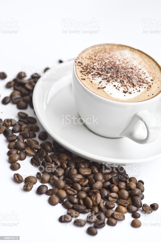 Cappuccino in white cup with coffee beans royalty-free stock photo