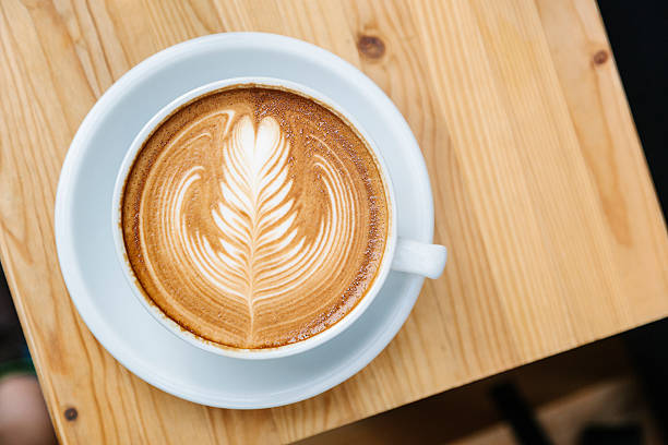 Cappuccino on a Wooden Table stock photo