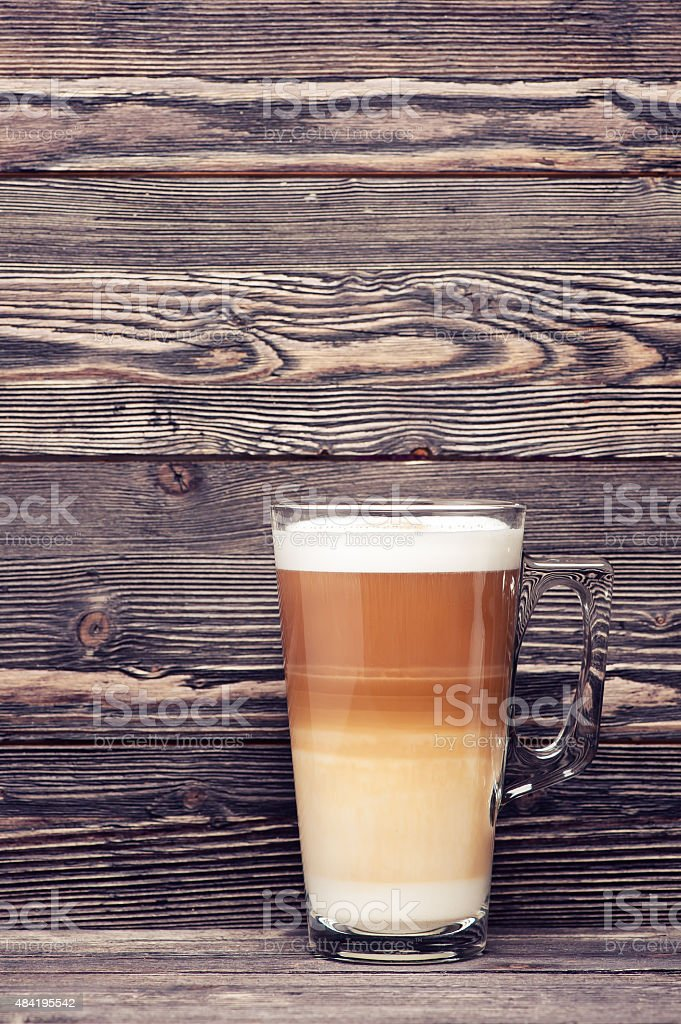 Cappuccino on wooden background stock photo