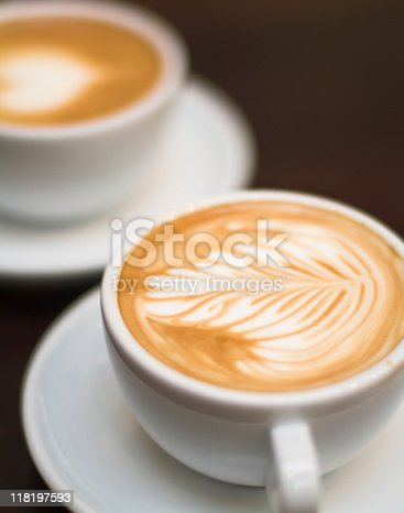istock Cappuccino - One cup with decorated foam and bokeh background 118197593