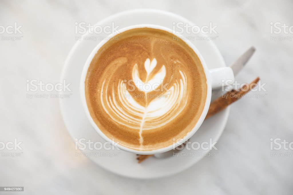 cappuccino or Latte art coffee made from milk on the white table in...