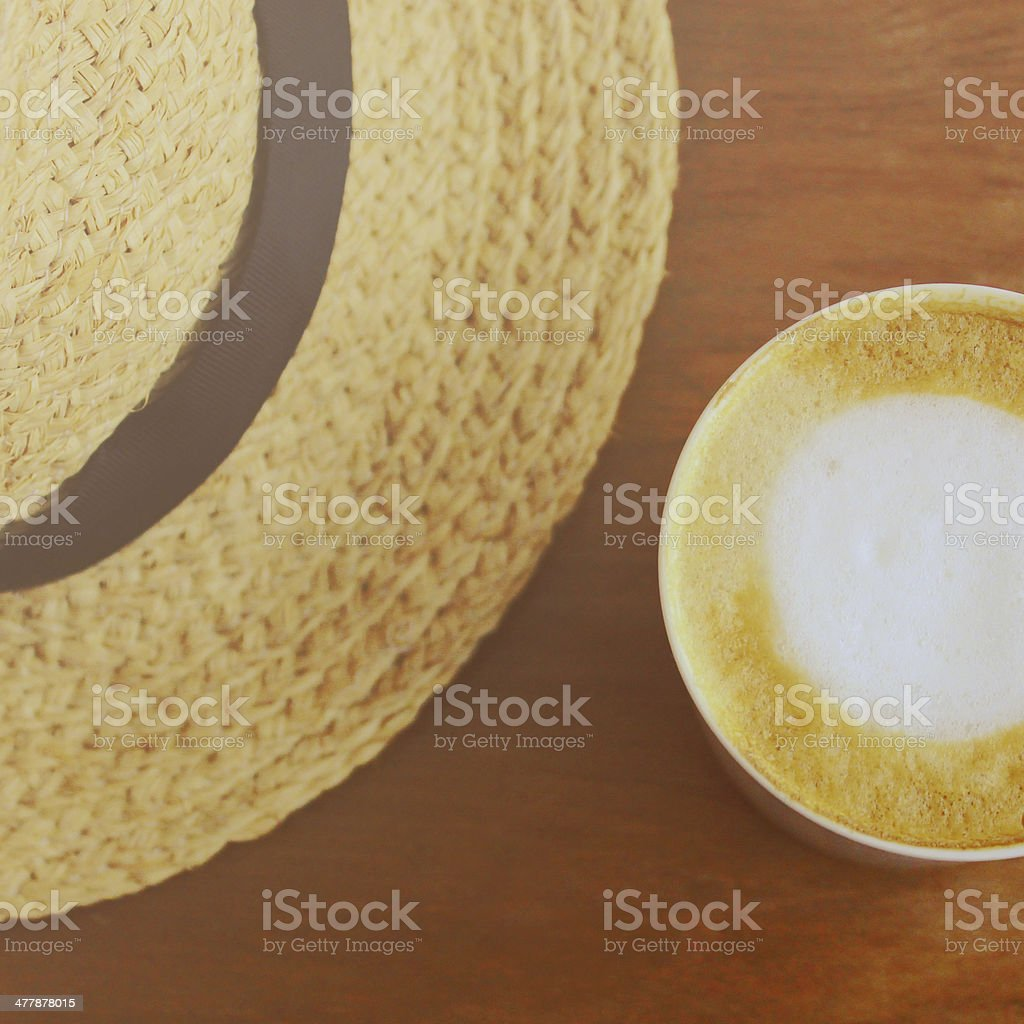 Cappuccino or latte coffee with hat, retro filter effect royalty-free stock photo