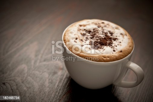 Creamy full fat Cappuccino coffee topped with grated dark belgium chocolate.Horizontal.
