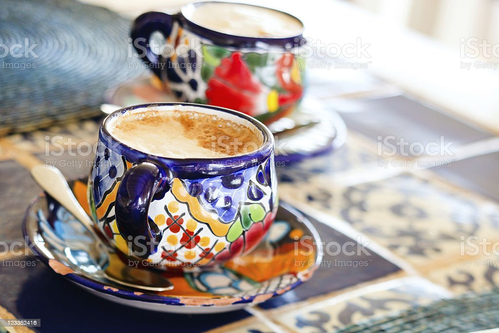 Cappuccino served in colorful cups royalty-free stock photo