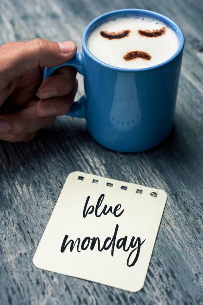 cappuccino with a sad face and text blue monday - blue monday foto e immagini stock