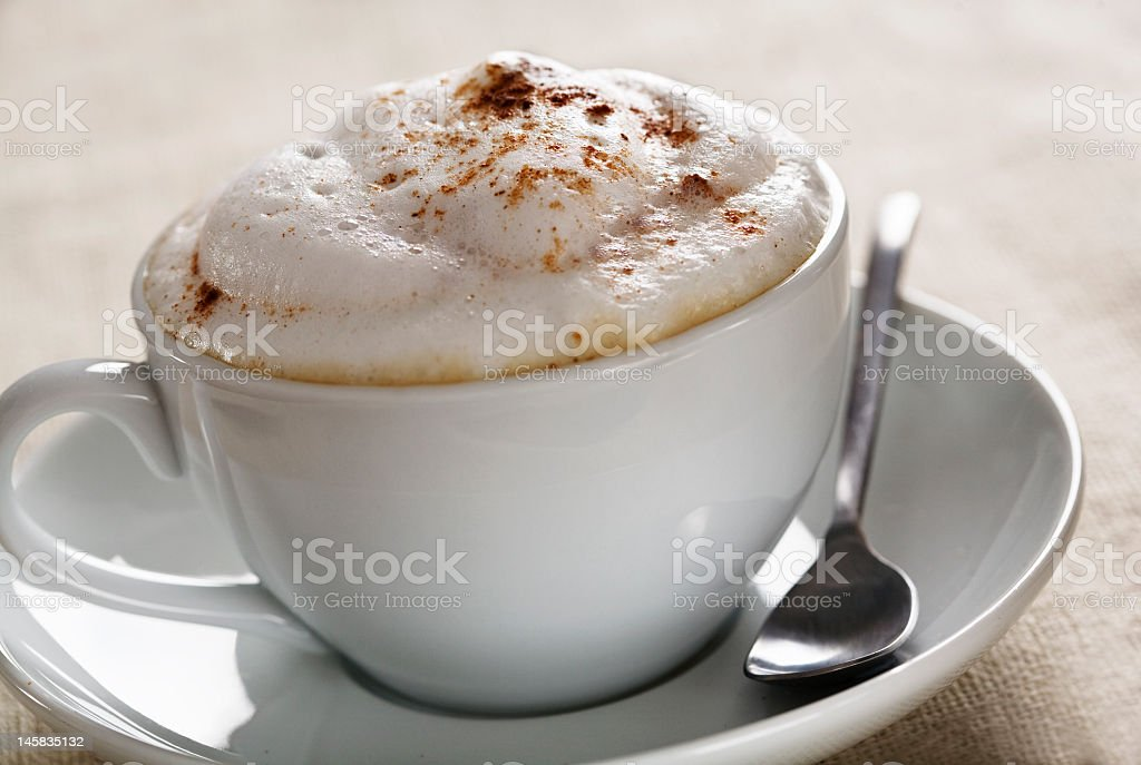 Cappuccino with foam in a white cup stock photo