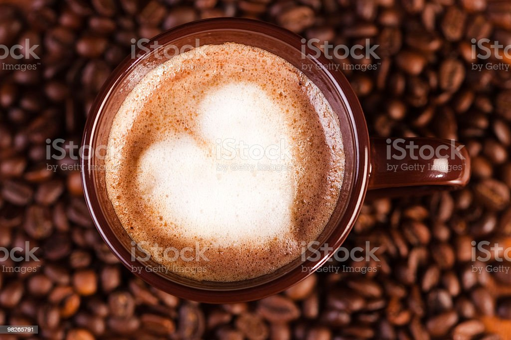 Cappuccino with heart shape made of milk froth royalty-free stock photo