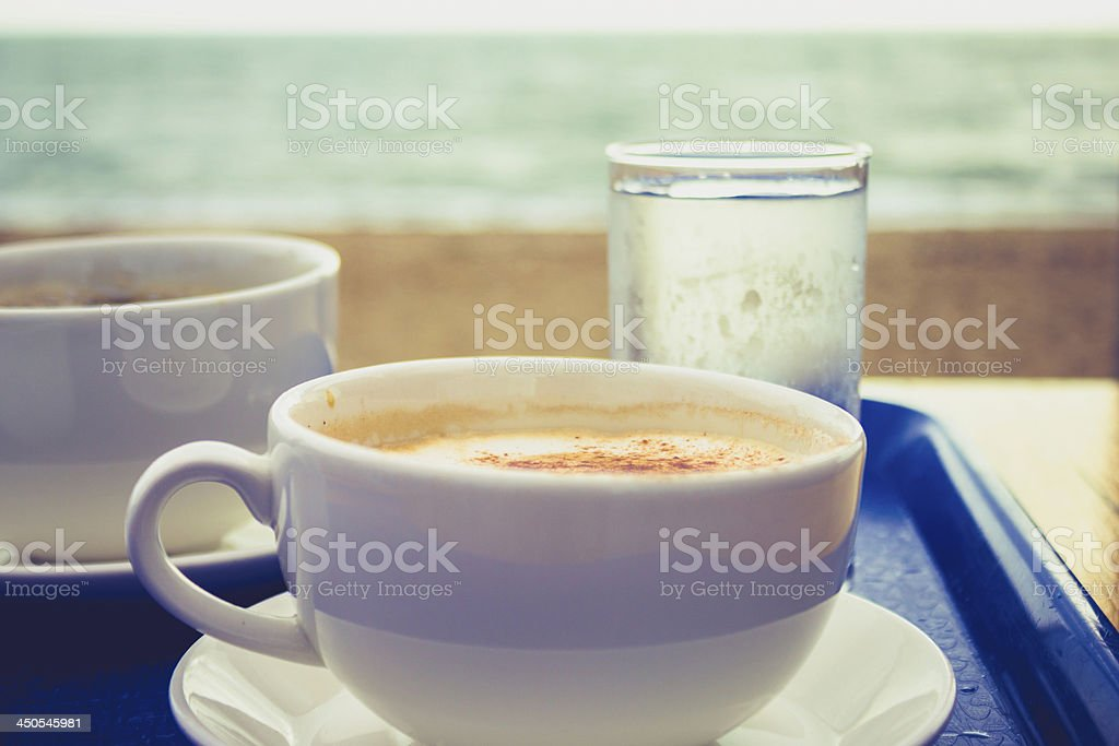 Cappucino and coffee on tray by the sea royalty-free stock photo