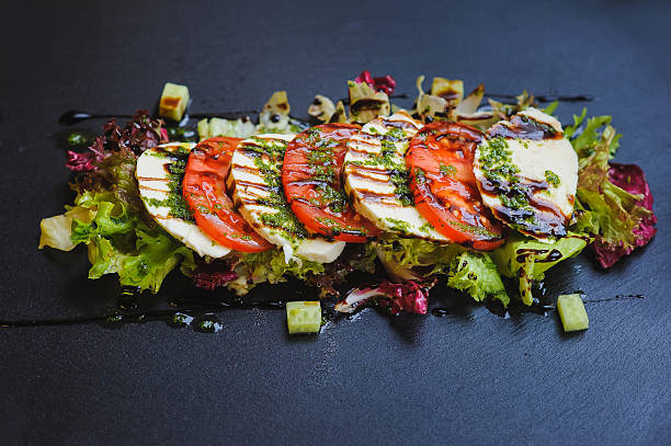 caprese - italian salad on dark plate - caprese salat stock-fotos und bilder
