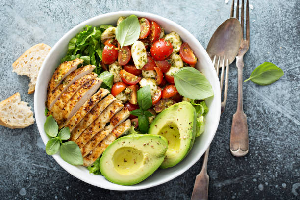 Caprese lunch bowl with grilled chicken stock photo