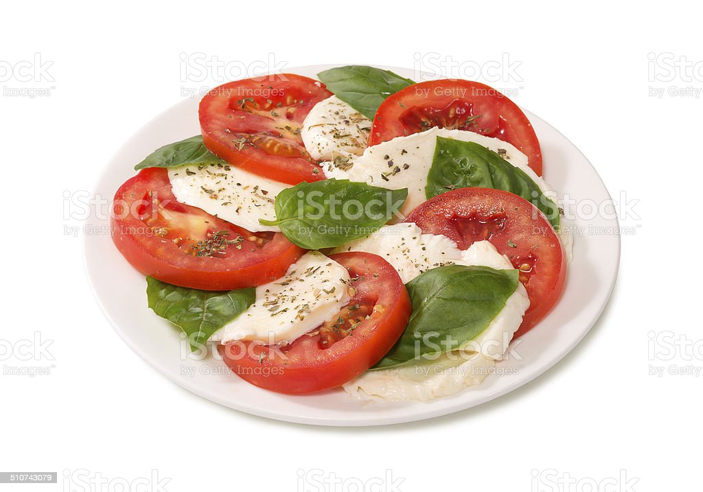 caprese on a white plate stock photo