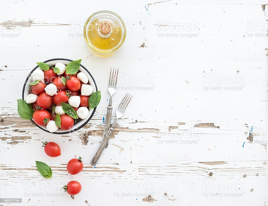 Caprese salad: cherry-tomatoes and mozzarella in metal bowl with stock photo