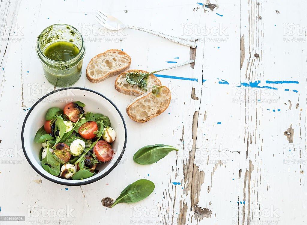 Caprese salad, chiabatta slices. Cherry-tomatoes, baby spinach and mozzarella stock photo