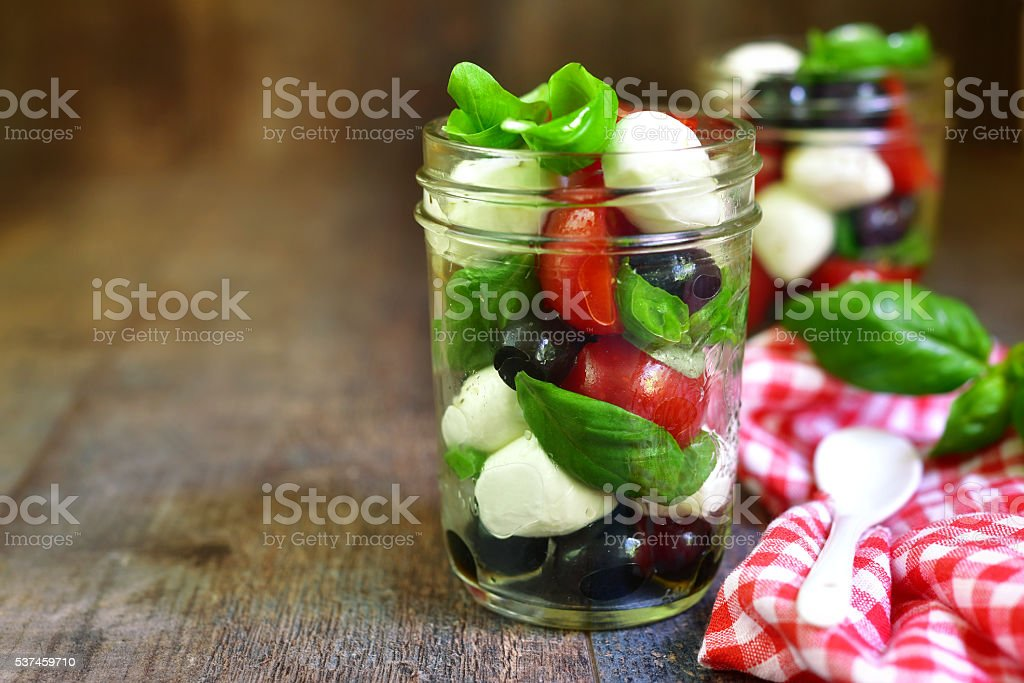 Caprese salad in a mason jar. stock photo