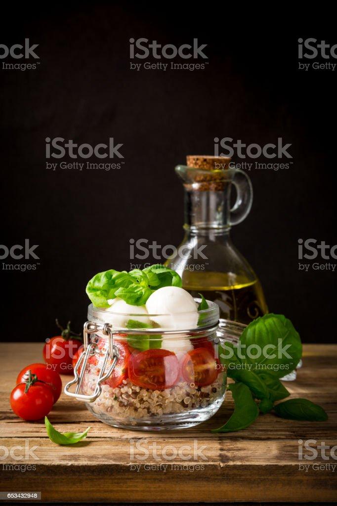 Caprese salad in glass jar. stock photo
