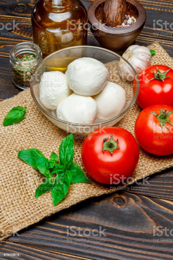 Caprese salad ingridients - Mozzarella and tomato royalty-free stock photo