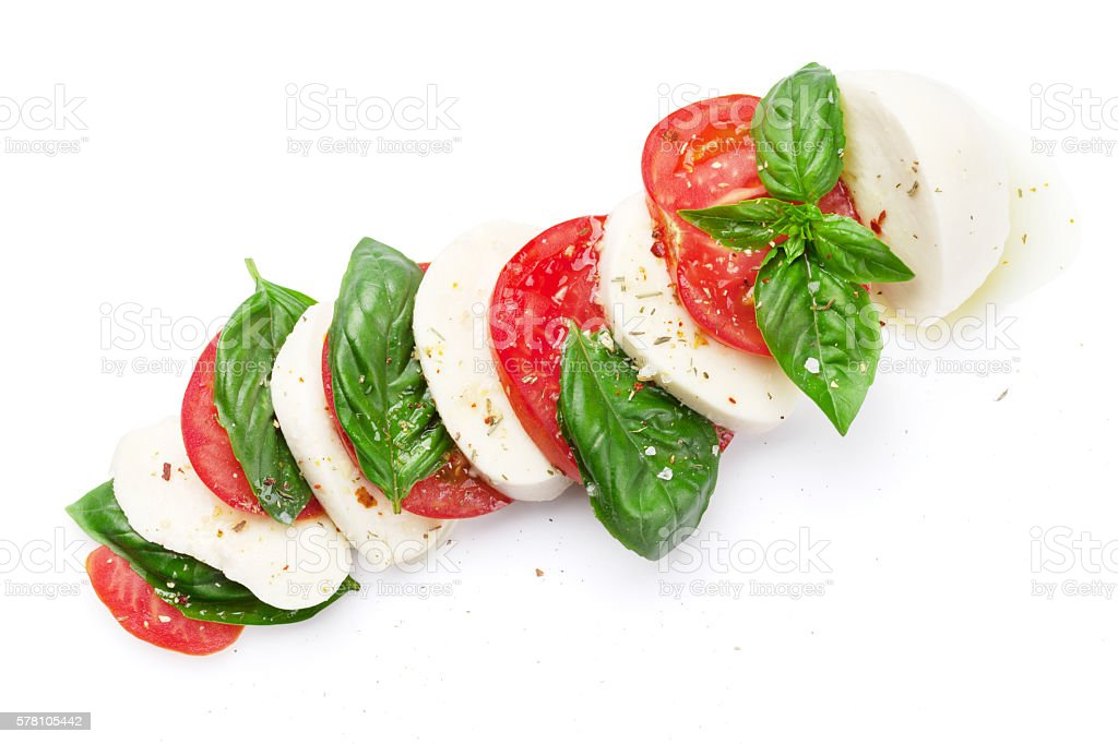 Caprese salad. Mozzarella, tomatoes and basil stock photo