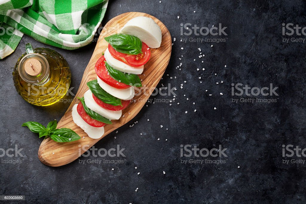 Caprese salad. Mozzarella, tomatoes and basil stock photo