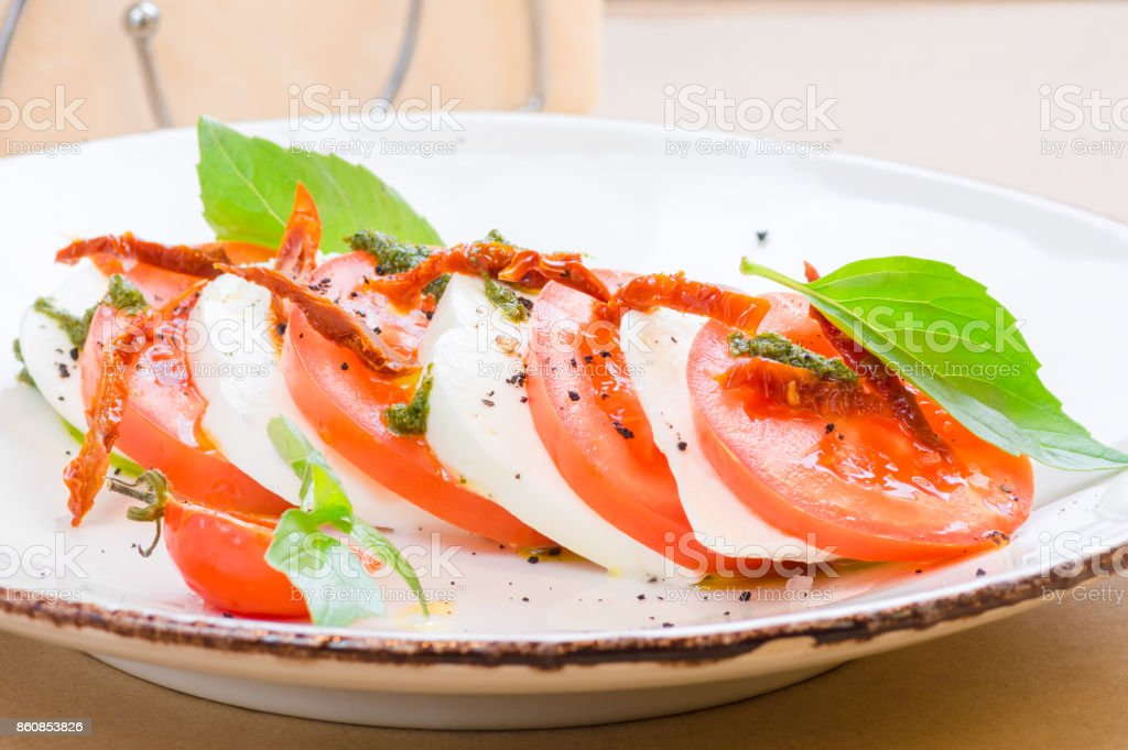 Caprese salad or Buffalo mozzarella with tomatoes stock photo