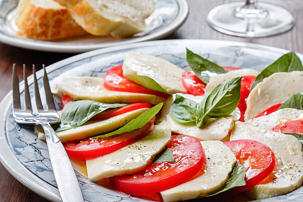 caprese salad - rikmcrae stock photos and pictures