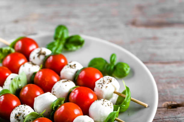 Caprese salad - skewer with tomato, mozzarella and basil, italian food and healthy vegetarian diet concept stock photo