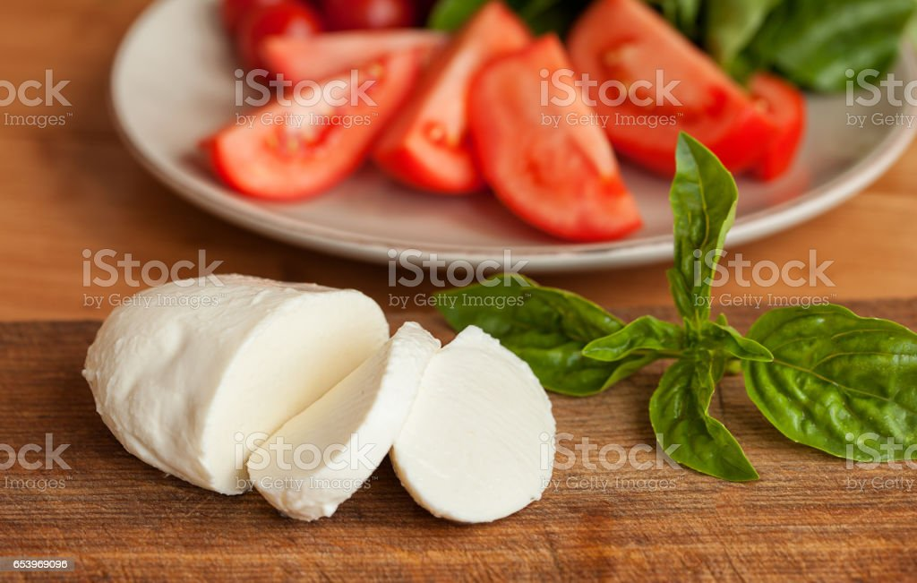 Caprese Salad. Tomato and Mozzarella slices with basil leaves. stock photo