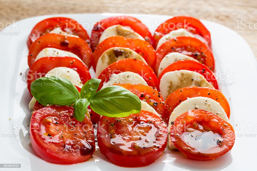 Caprese salad tomato mozzarella with basil stock photo