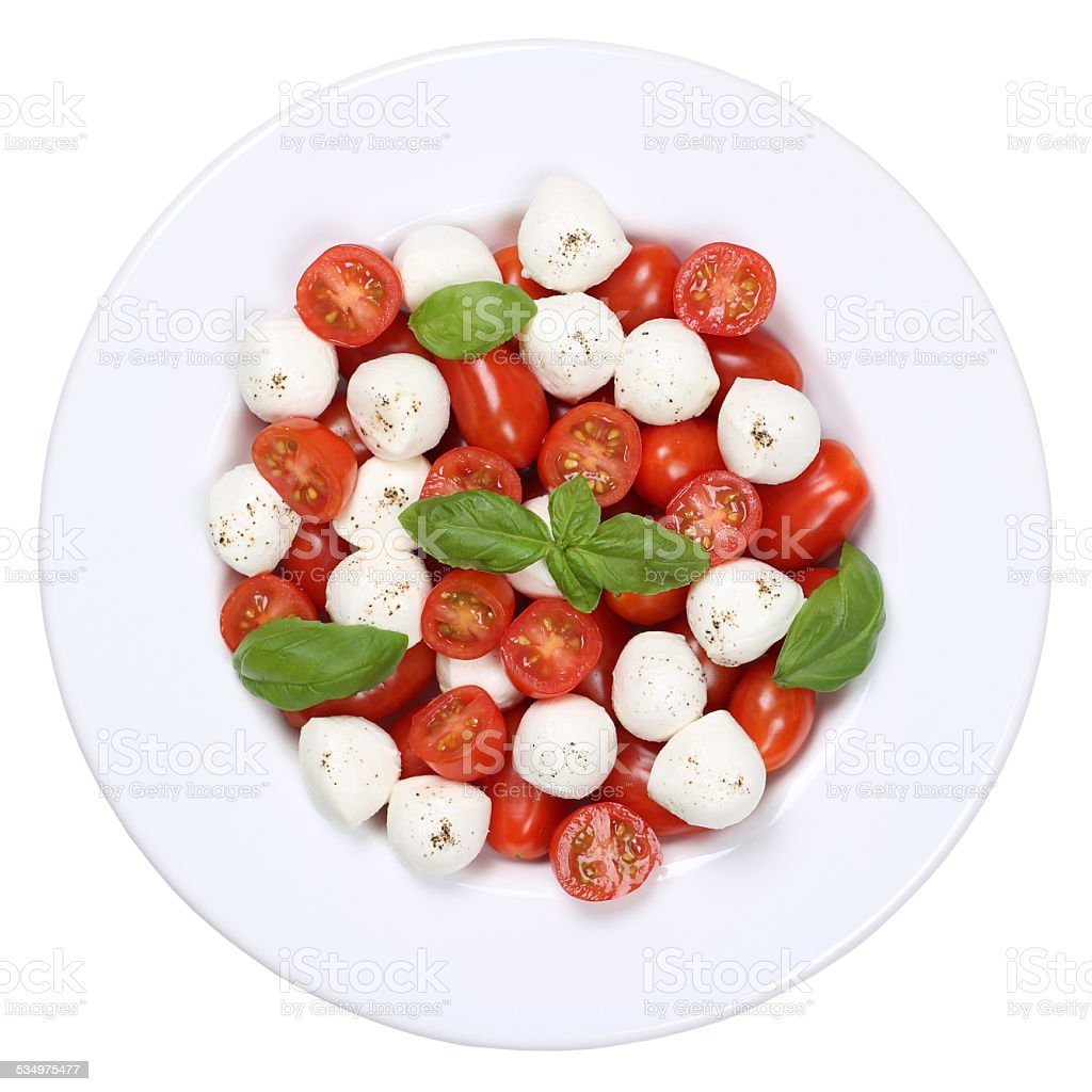 Caprese salad with cocktail tomatoes and mozzarella from above stock photo