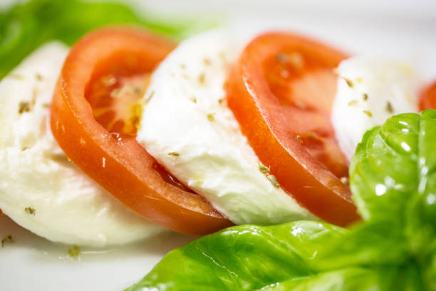 Caprese salad with mozarella cheese, tomatoes and basil stock photo