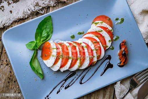 Caprese salad with mozzarella and tomato