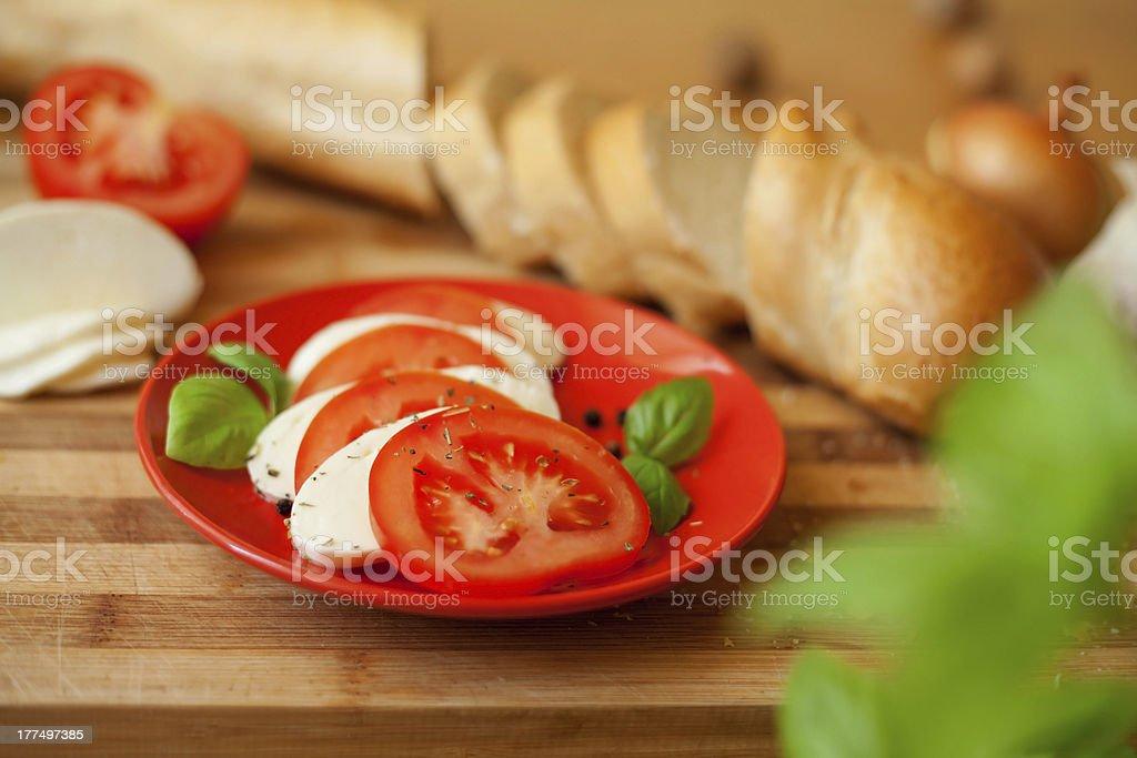 caprese tomato mozarella basil pepper olive herbs pesto oil royalty-free stock photo